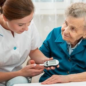 30095131 - female nurse measuring blood glucose level of senior woman